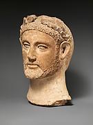 Terracotta head of a man wearing a wreath