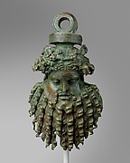 Bronze handle attachment in the form of a mask