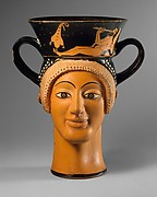 Terracotta kantharos (drinking cup with high handles): two female heads