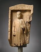 Limestone funerary monument of a beardless man