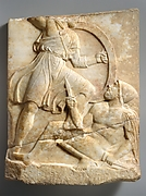 Fragment of a marble grave stele of a warrior