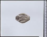 White stone engraved gem