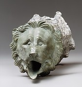 Bronze water spout with lion mask (one of a a pair)