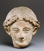 Terracotta head of a wreathed youth