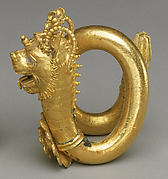 Gold spiral earring with lion-griffin terminal