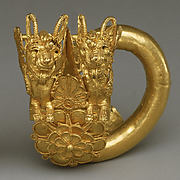 Gold spiral with double lion-griffin-head terminal