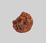 Amber disk with a nereid riding a triton