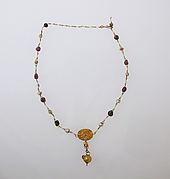 Necklace with pendant and glass beads