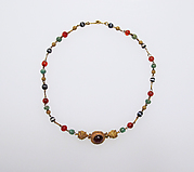 Gold, emerald, carnelian, banded onyx, and garnet necklace