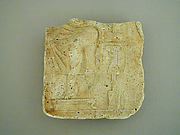 Plaster relief fragment with a male figure on a throne