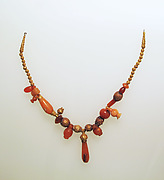 Necklace of assorted gold and carnelian beads, with gold terminals and carnelian pendant