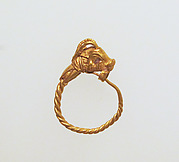 Gold earring with head of a goat