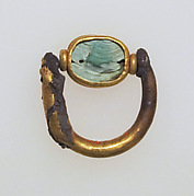Ring with scaraboid