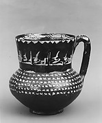 Ewer with repeated Arabic phrase,