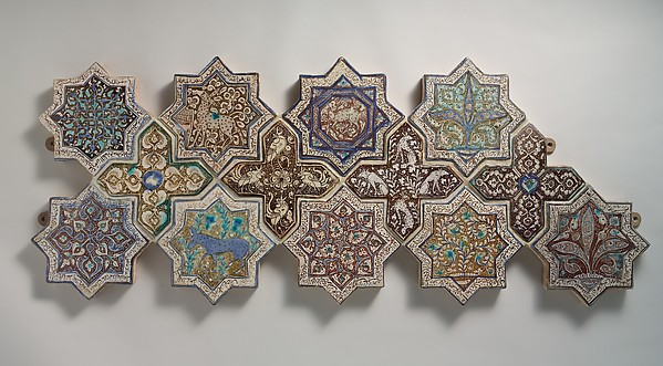 Panel Composed of Cross- and Star-shaped Tiles