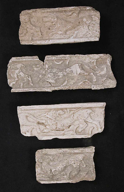 Fragments of a Frieze with Chasing Animals