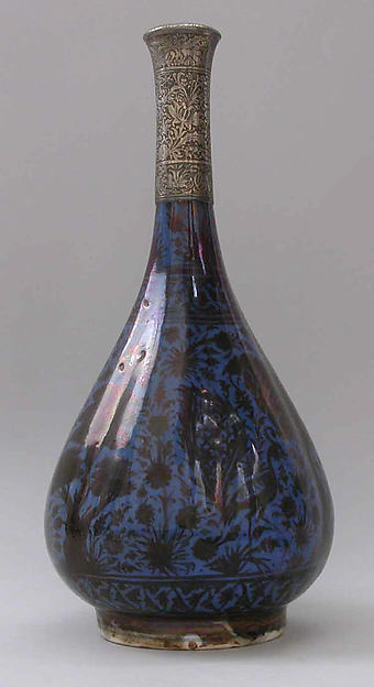 Bottle Depicting a Peacock in Foliage