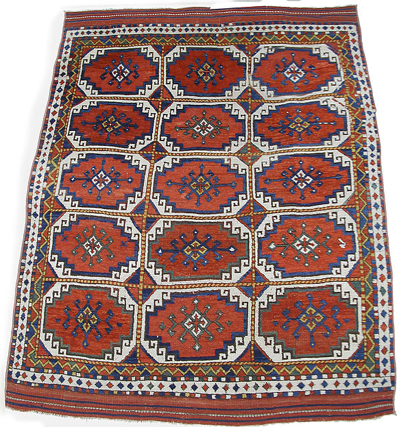 Carpet with Repeating Medallion Pattern on Red Background