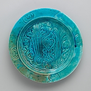 "Turquoise Dish with Carved Arabic Inscription in Floriated Kufic Reading ""al-'izz"" (""Glory"")"