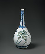 Bottle Depicting Storks in Blue and Yellow on a White Background