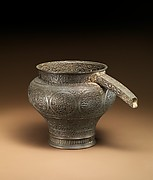 Spouted ewer with calligraphic decoration