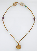 Gold Necklace with Gold Cross, Two Amethysts, and an Emerald Plasma