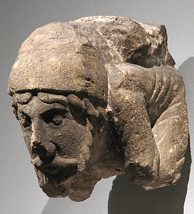 Corbel with Crouching Male Figure