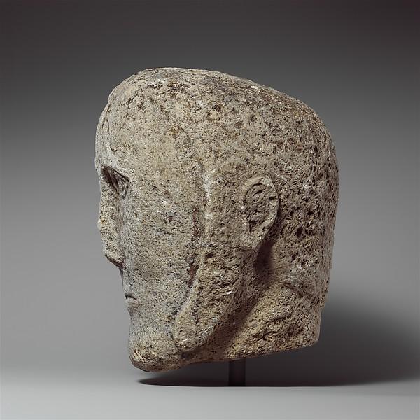 Head of a Man Wearing a Cap or Helmet