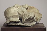 Boy Mourner resting on Helmet and Shield