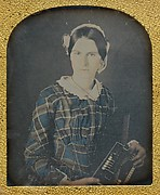 Young Woman with an Early Accordion