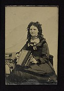 "Woman Holding a ""Flutina"" Accordion"