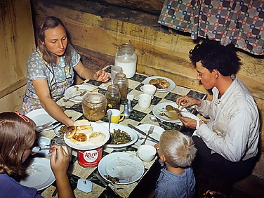 The Fae and Doris Caudill Family Eating Dinner in Their Dugout