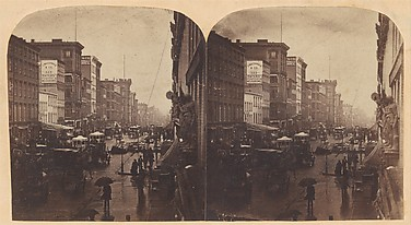 [Broadway, New York City, in the rain]