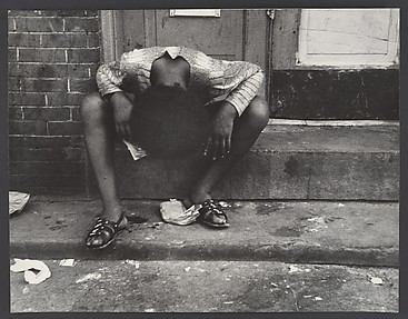 [Street Scene: Exhausted Woman with Head Between Knees, New York City]