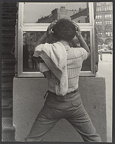 [Street Scene: Young Man Fixing Hair in Window, New York City]