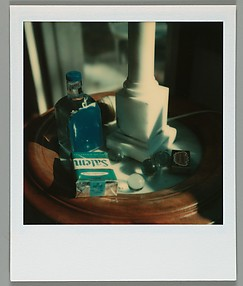 [Arrangement of Objects on Table: Cigarettes, Marbles, Matches]