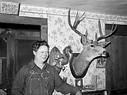 Mildred Anthony, Standing by Mounted Animals Which She Killed