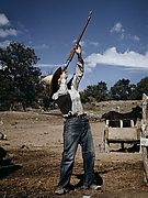 Nell Leathers, Homesteader, Shooting Hawks Which Have Been Carrying Away Her Chickens
