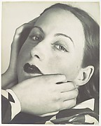 [Portrait Composition: Close-up, three-quarter view of woman with hands at her face]