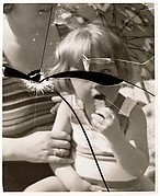 [Mother with Child on Beach, Reflected in Broken Mirror]