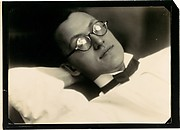 [Diagonal View of Young Man Wearing Glasses, Wing Collar, and Bow Tie]