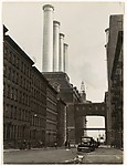 [City Street Ending at Factory with Four Smokestacks]