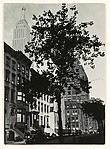 [Empire State Building above Brownstone Buildings]