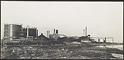 [Industrial Site: Smokestack and Oil Tanks]