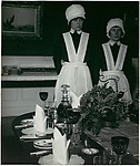 Parlourmaid and Under-Parlourmaid Ready to Serve Dinner