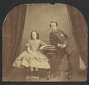[Young Girl, Seated, with Young Boy, Leaning on Table]