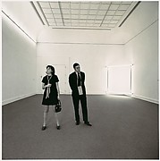 [Two Gallery-goers viewing Dan Flavin's work in the exhibition