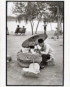A Professor Corrects His Class Papers by the Lake in the Newly Build King Chan Park, Peking