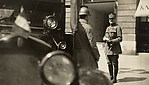 [Marshal Foch on Street with Automobile in Foreground]
