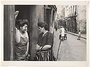 [Two Women Talking in Doorway, Paris]